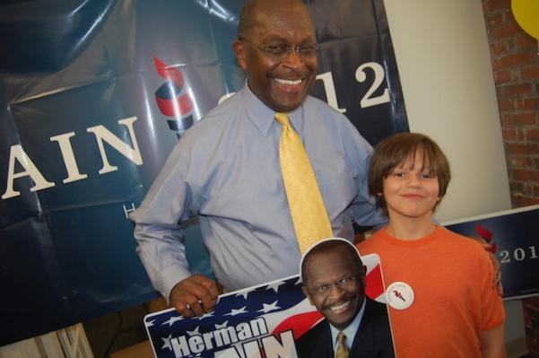 During the 2012 Superhero Primary, Ari Garnick discussed the perils of kryptonite and the 9-9-9 economic plan with Republican Herman Cain.